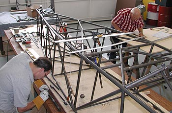 Mark Eckenrod and Curtis work on the Pitts Model 14 prototype in late June 2003