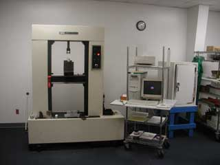 A modern computerized system was used for destructive testing and recording of laminated spar samples.